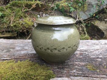 Lidded jar, white slip, celadon glaze.