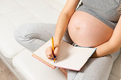 pregnant-woman-hands-writing-something-b