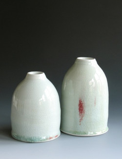 A pair of bottle vases