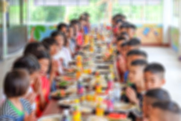 Thai kids eating lunch in a social schoo