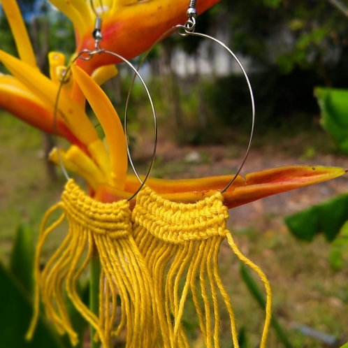Women's large loop braided macramé earrings.