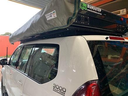 Prado 120 lowe mount Tough Touring rack Bundutop Tent.jpg