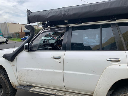 GU patrol with Tough Touring Rack and Ostrich wing awning.jpg
