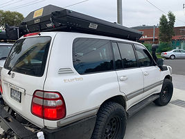 100 series with Stealth and Tough Touring rack.jpg