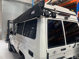 Ostrich Wing fitted with Tough Touring Brackets on Apollo Pop Top Camper Conv.jpg