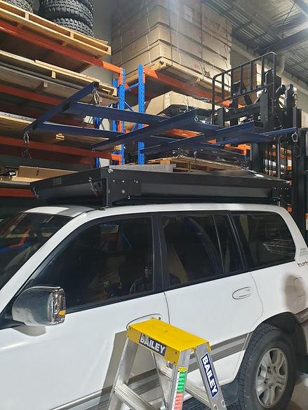 Tough Touring Rack on 100series Toyota a