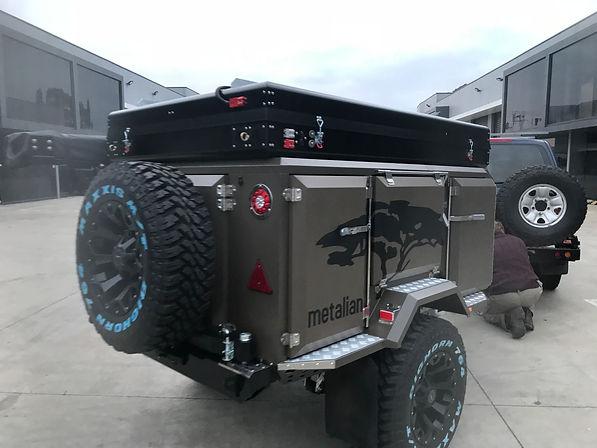 Black Bundutop fitted to Metalian Camper Low mount.jpg