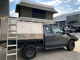 Hilux Extra Cab with Bundutec Bundutop Roof top tent fitted by tough touring.jpg
