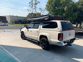 Bundutop King Fitted to Volkswagon Amarok on Tough Touring Cantilever rack.jpg