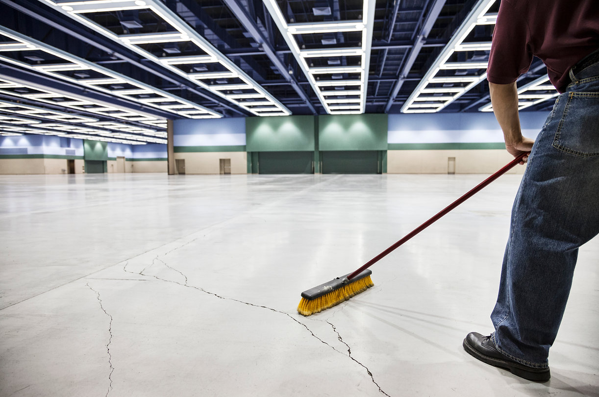 a-low-view-closeup-of-a-man-sweeping-the
