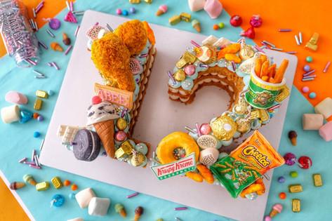 Junkfood themed multiple number monogram cake