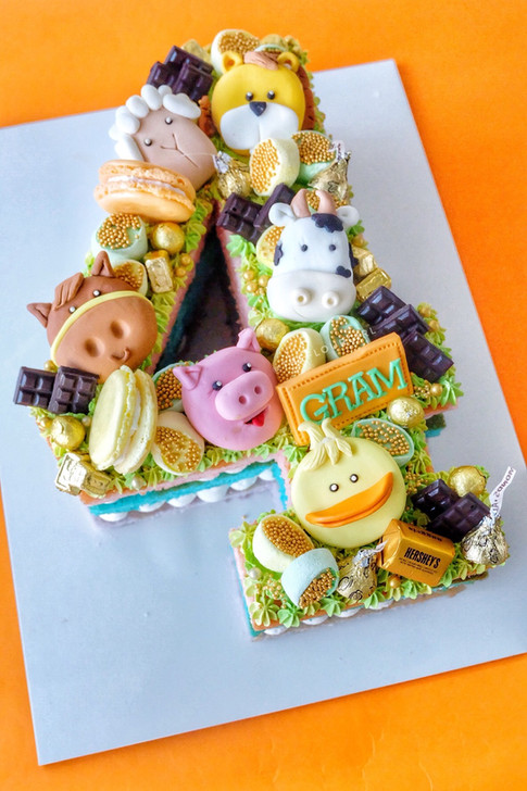 Farm animals themed single number monogram cake