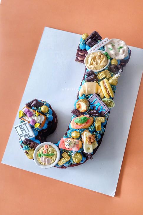 Favorite food themed single letter monogram cake
