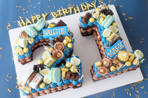 Basic color themed multiple number monogram cake