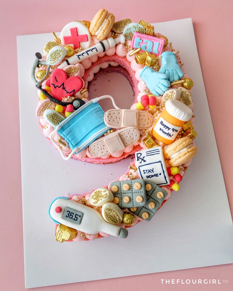 Doctor themed single number monogram cake