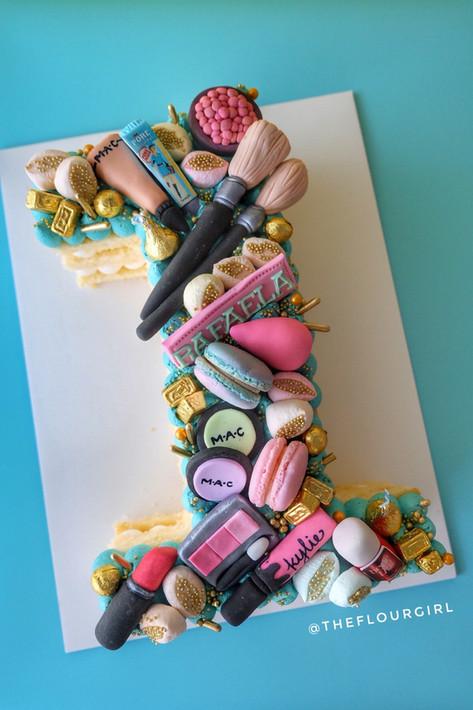 Make up themed single number monogram cake