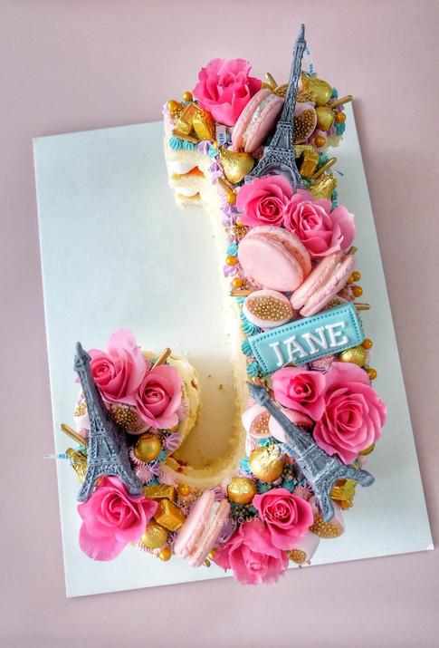 Parisian themed single letter monogram cake
