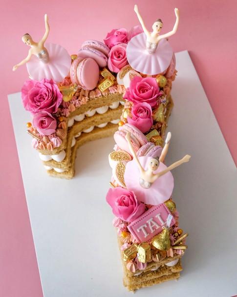 Ballerina themeed single number monogram cake