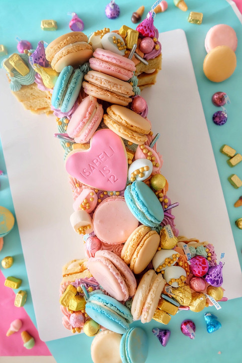 Macaron themed single letter monogram cake