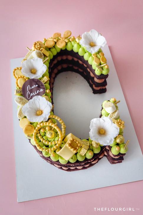 Jewels themed Single Letter Monogram Cake