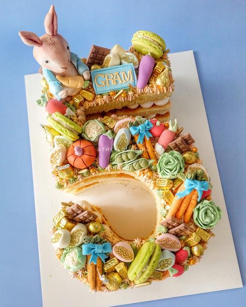 Peter Rabbit themed single number monogram cake