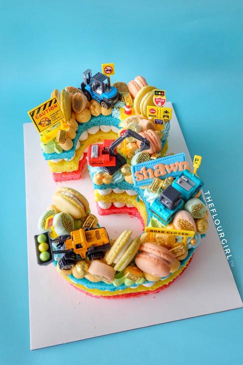 Trucks and excavators Single Number Monogram Cake