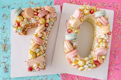 Macaron themed single number monogram cake