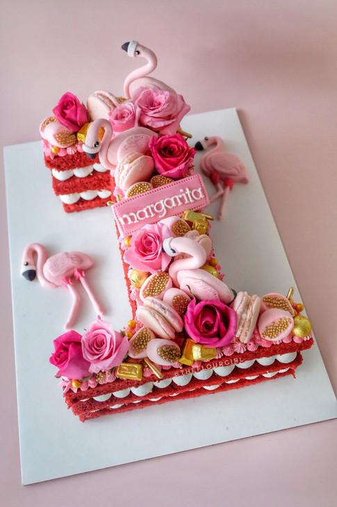Flamingo themed single letter cake