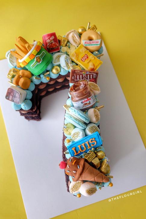 Junkfood themed single number monogram cake