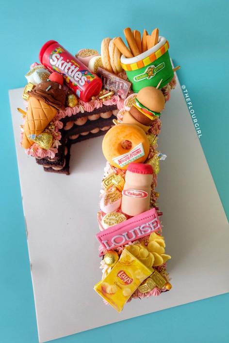 Junkfood themed single letter monogram cake