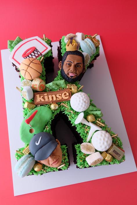 Tiger x Lebron themed single letter monogram cake