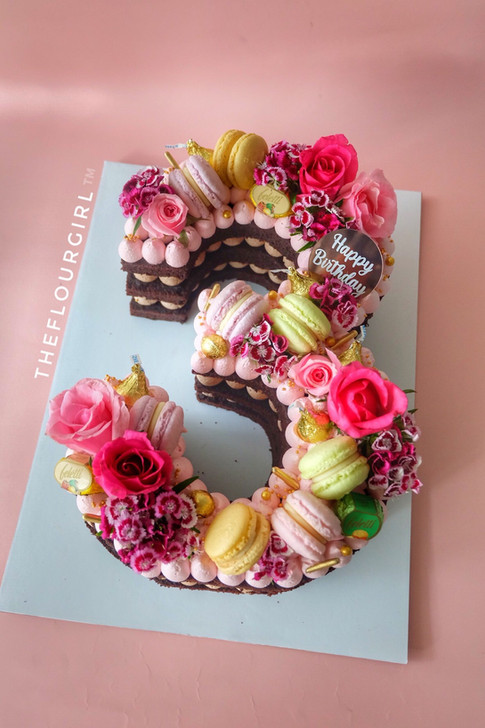 FLOWERS AND MACARONS THEMED NUMBER CAKE