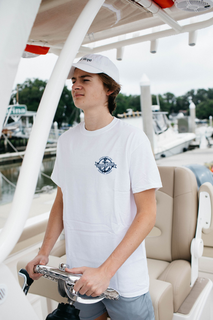 Items pictured: White Savannah Sound T-shirt & White Isle of Hope Ballcap
