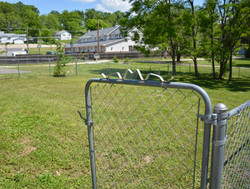 fenced in side yard at Duff Apartments - 1