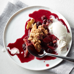 Apple Blueberry Crisp, plated with ice cream