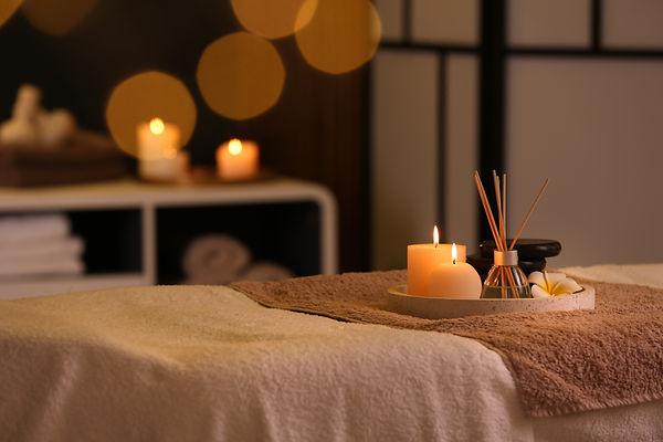 Burning candles and aromatic reed freshe