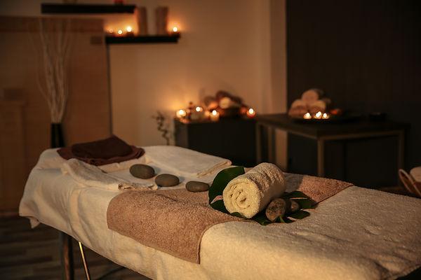Interior of modern massage room in candl