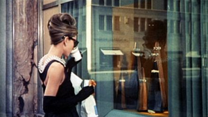 Audrey Hepburn views the window display of the Tiffany & Co. store on 5th Avenue. Bergdorf Goodman is located on the same street