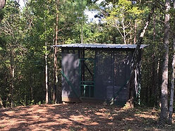 One of two screened in meditation decks with firepit and storage