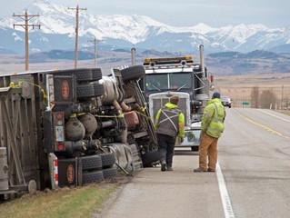 Hurricane-force winds topple trucks