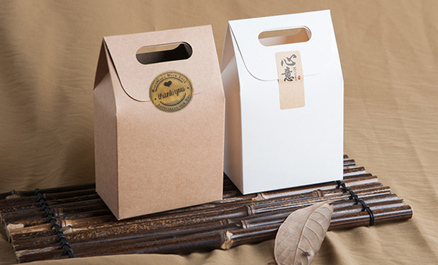Kraft paper favor boxes with handle sealed with label