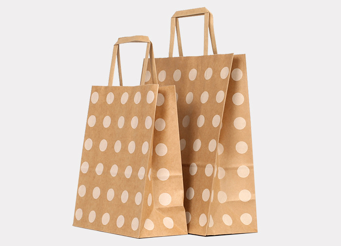 Wholesale cheap flat handle Kraft paper gift bags with white dot pattern printed