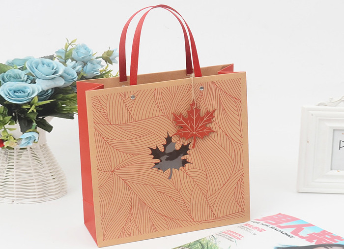 Beautiful decorated and printed kraft gift bags with flat handle and clear window