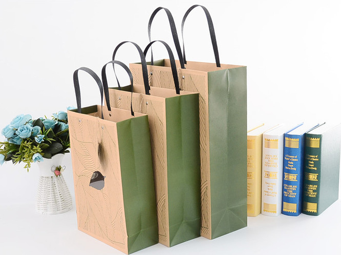 Luxury printed kraft gift bags with flat handle and clear window