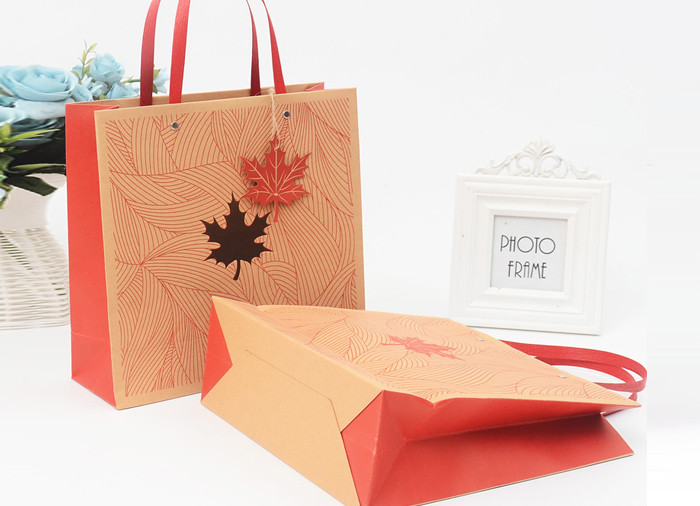 Wholesale printed brown kraft gift bags with flat handle and window