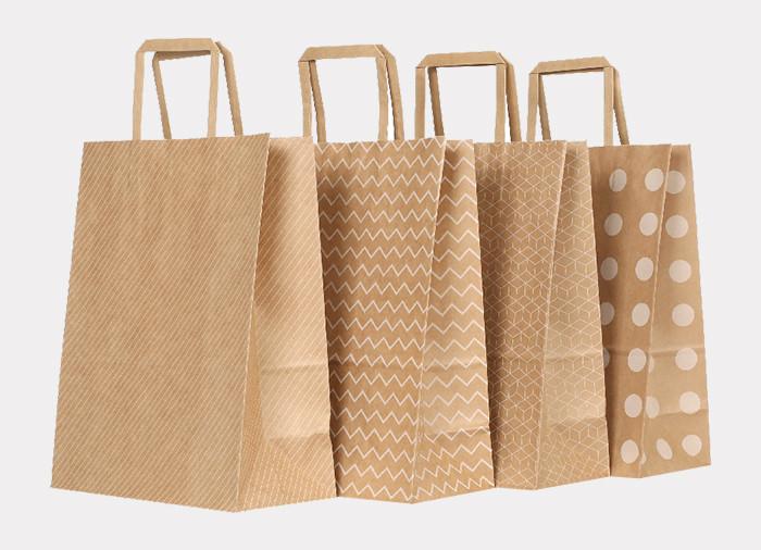 White printed brown Kraft printed paper gift bags with flat paper handles