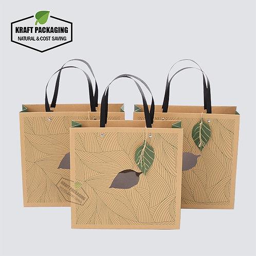 Luxury Green printed flat handle Kraft gift bags with PVC window, leaf hangtag