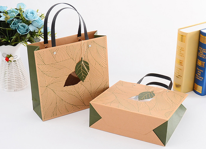 Luxury green printed kraft paper gift bags with flat handle and window
