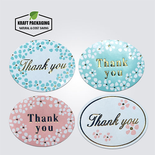 White oval shaped sticker with gold foil stamping thank you text label