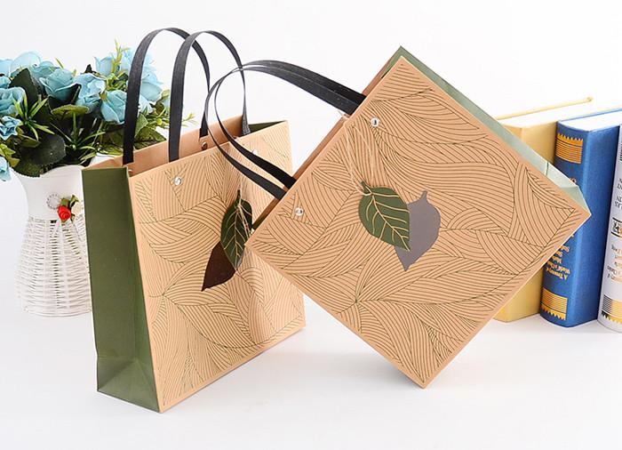 Brown Kraft printed paper gift bags with rivet fixed flat handle